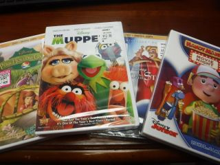 Disney Movie Bundle Pack Of 4 Dvds The Sword In The Stone,  Muppets,  Pixie,  So On.