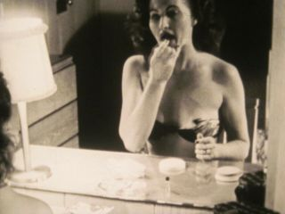 16mm Film Figure Sexy Girl In Bikini Makes Up Face In Front Of Mirror