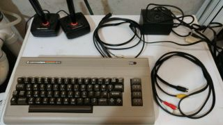 Commodore 64,  Includes Joysticks,  Manuals,  Power And Video Cables